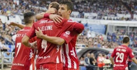 11/06/2015 Sandaza y Lejeune se abrazan tras un gol del Girona. El Girona despedaza al Zaragoza Los de Machín sacan la rabia y están a un paso de la final por el ascenso DEPORTES LFP