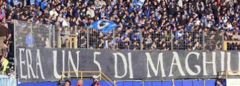 Bastia' supporters stand up as they pay respect to the victims of the Furiani Stadium tragedy before the French L2 football Bastia vs Metz in the Armand Cesari stadium in Furiani, French Corsican island, on May 1, 2012. On May 5, 1992, 18 people were killed and 2,300 injured when a temporary stand collapsed at the Furiani Stadium in Bastia prior to a French Cup semi-final between the home side and Marseille. The French Football Federation (FFF) and Professional Football League (LFP) announced on April 27, 2012 that no football matches will take place in France on May 5, the 20th anniversary day of the Furiani disaster. AFP PHOTO / PASCAL POCHARD-CASABIANCA TELETIPOS_CORREO:SPO,SPO,%%%,%%%