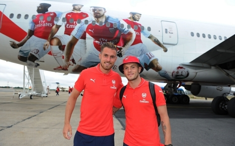 LONDON, ENGLAND - JULY 12: (EXCLUSIVE COVERAGE) (L-R) Arsenal's Aaron Ramsey and Jack Wilshere in front of the Emirates plane as they travel to Singapore for the Barclays Asia Trophy at Stansted Airport on July 12, 2015 in London, England. (Photo by Stuart MacFarlane/Arsenal FC via Getty Images)
