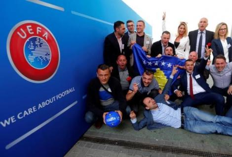 Members of the Kosovo media team celebrate outside the convention centre where the European football group UEFA admitted Kosovo as its newest member in Budapest, Hungary, May 3, 2016. REUTERS/Laszlo Balogh