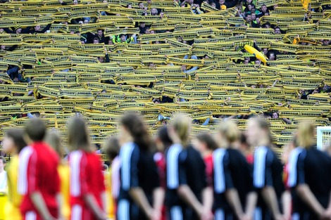 "Supporters of Borussia Dortmund hold scarves to cheer their team prior to the German cup "" DFB Pokal "" final football match Borussia Dortmund vs Bayern Munich at the Olympiastadion in Berlin on May 12, 2012. AFP PHOTO / JOHN MACDOUGALL (Photo credit should read JOHN MACDOUGALL/AFP/Getty Images)"