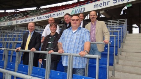 Bob Symns (chief executive, Peterborough United - middle row, centre) and representatives of Peterborough City Council with Jon Darch (Safe Standing Roadshow) and Hannover 96 staff among rail seats in the AWD Arena (Germany).